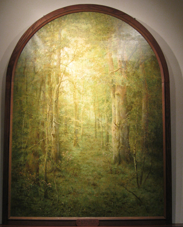 The light in the forest casts a holy spell in George Inness Jr.'s painting.
