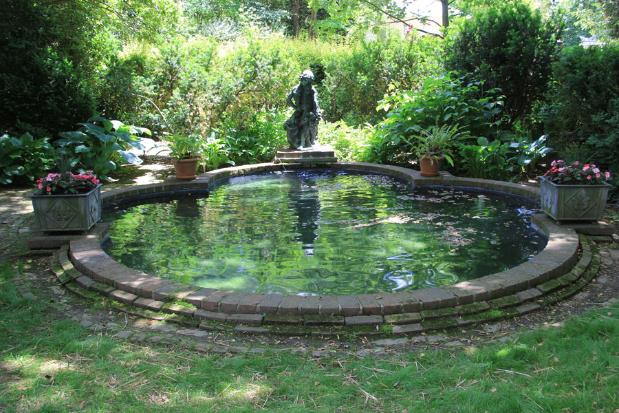 At the end of the bowling green a shady pool offers a perfect spot for a tryst.