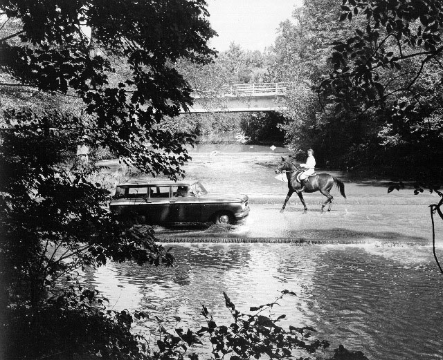 Cheap thrill: crossing the ford through Rock Creek in 1960.